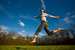 Man jumping in a field. Young man jump in a field Royalty Free Stock Image