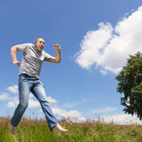 Man is jumping in front of blue sky Royalty Free Stock Photo