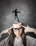 Man jumping into a girl's head Royalty Free Stock Images