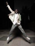 Man jumping and grabbing his crotch Stock Images