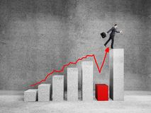 Man jumping on graph. Businessman jumping on big graph  in room Stock Images