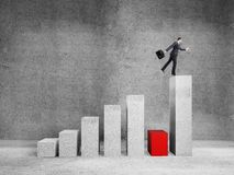 Man jumping on graph. Businessman jumping on graph  in room Royalty Free Stock Images