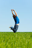 Man jumping on the green field Royalty Free Stock Photography