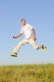 Man jumping on green field Stock Photography