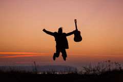 Man jumping with guitar Royalty Free Stock Photo