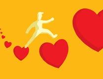 Man jumping between hearts Royalty Free Stock Photography