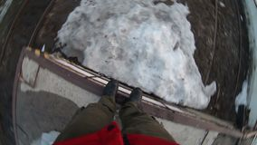 Man jumping from a height in feet of snow in the stock video footage