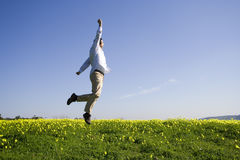 Man jumping high to sucess Stock Photography