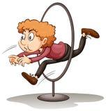 A man jumping through a hoop Royalty Free Stock Photos