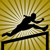 A man jumping in hurdle Race gold background Royalty Free Stock Photos