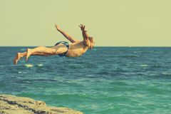 Free Man Jumping In Sea Stock Photography - 115387002