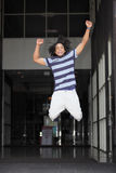 Man jumping for joy. Image of a young Jamaican man jumping for joy Stock Image
