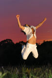 Man jumping for joy. Sunset background Stock Images