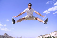 Man jumping in joy. Healthy happy man jumping in joy of life Stock Images