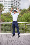 Man jumping for joy. Stock image of a military man jumping for joy Stock Photo