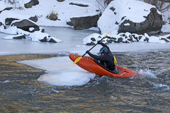Man Jumping A Kayak On To Ice Stock Image