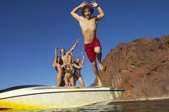 Man Jumping Into The Lake Stock Photos