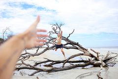 Man Jumping on Leafless Tree Royalty Free Stock Photos