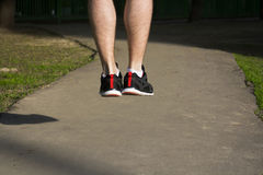 Man is jumping legs. Man is jumping, strong legs, training outside Stock Photo