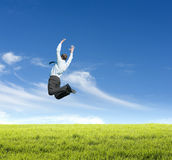 Man jumping on  meadow Stock Photos