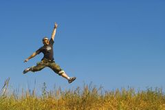 Man jumping on a meadow Royalty Free Stock Photos
