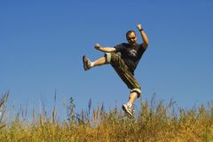 Man jumping on a meadow Royalty Free Stock Photo