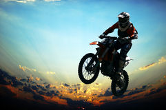 Man jumping on Motorcycles Stock Images