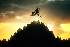 Man jumping on mountain top Royalty Free Stock Photos