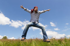 Man is jumping in the nature. For fun Royalty Free Stock Photo
