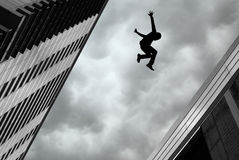 Man Jumping off Building Stock Photos
