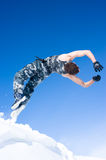 Man jumping off a cliff. Man in a camouflage jumping off a cliff Stock Photos