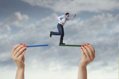 Man jumping from one side to the other Stock Photos