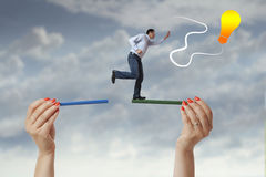 Man jumping from one side to the other Stock Photography