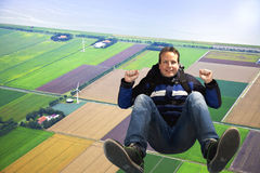 Man jumping out of plane. With parachute Royalty Free Stock Images