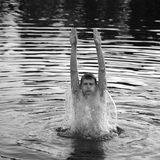 Man jumping out of water Royalty Free Stock Photo