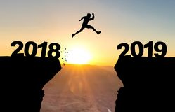 Man jumping over abyss with text 2018/2019. Man jumping over abyss with text 2018/2019 in front of sunset royalty free illustration