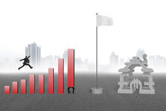 Man jumping over bar charts to flag with currency house Royalty Free Stock Photos