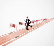 Man jumping over barrier Royalty Free Stock Image