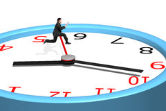 Man jumping over clock pointer Stock Photo