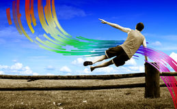 Man jumping over the fence. On the rainbow royalty free stock photos