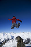 Man jumping over the mountains Stock Photos