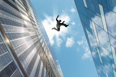 Man Jumping Over the Roof Stock Image