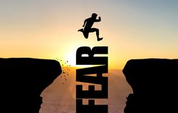 Man jumping over text FEAR. stock illustration