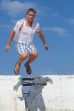 Man Jumping Over Wall Royalty Free Stock Photo