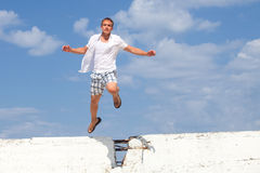 Man Jumping Over Wall Royalty Free Stock Images