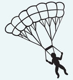 Man jumping with parachute Royalty Free Stock Image