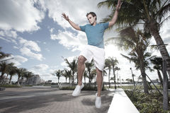 Man jumping from a park bench Stock Photography