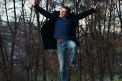 Man jumping in the park Royalty Free Stock Photo