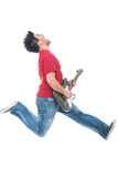 Man jumping while playing guitar Royalty Free Stock Photos