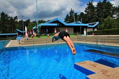 Man jumping in the pool royalty free stock photography